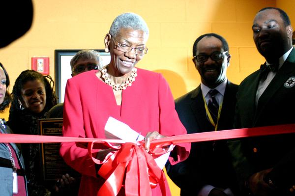 Mrs. Helena Nobles- Jones cuts the ribbon in the official ceremony dedicating the CHFHS auditorium to her.