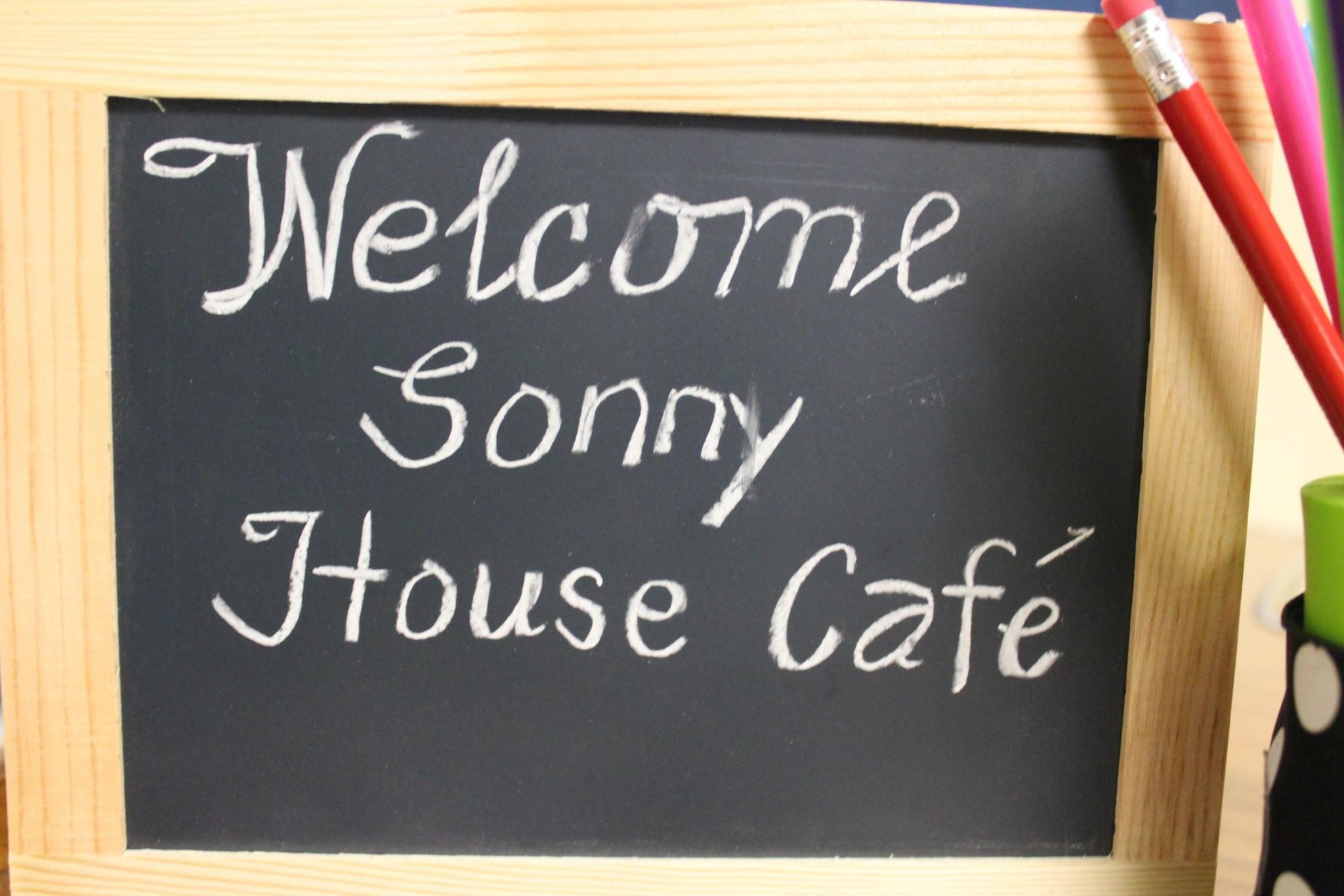 welcome to sonny house cafe sign