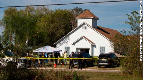 Law enforcement officials investigate a mass shooting at the First Baptist Church in Sutherland Springs, Texas, on Sunday, Nov. 5, 2017. NICK WAGNER / AMERICAN-STATESMAN