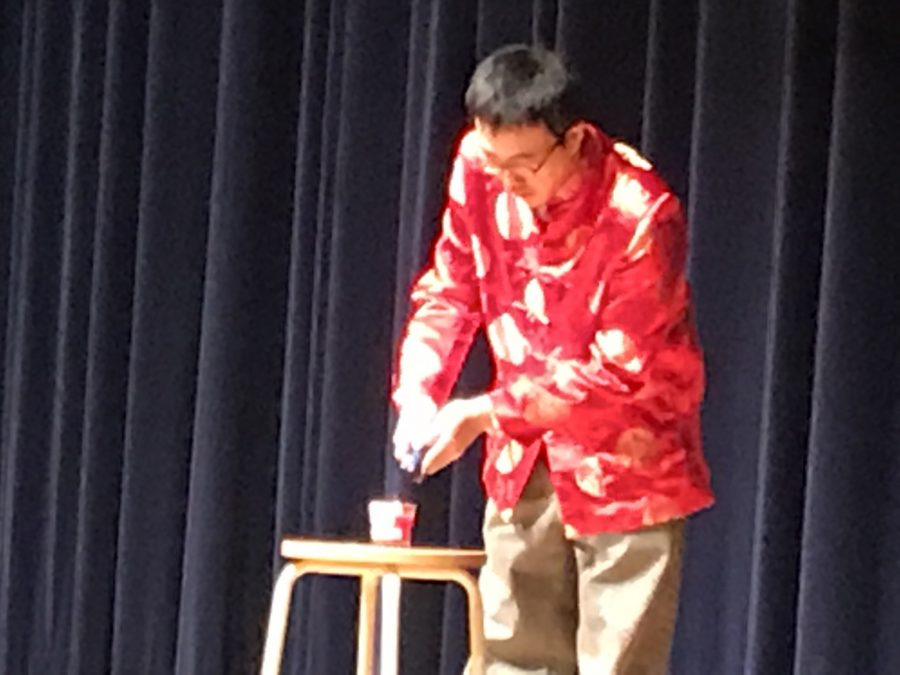Mr. Wu lighting the candle of induction